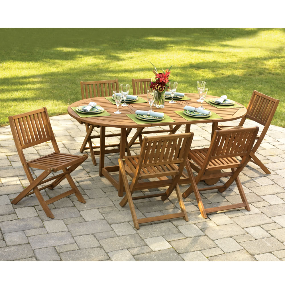 The Gateleg Patio Table And Stowable Chairs Hammacher Schlemmer pertaining to patio table and chairs